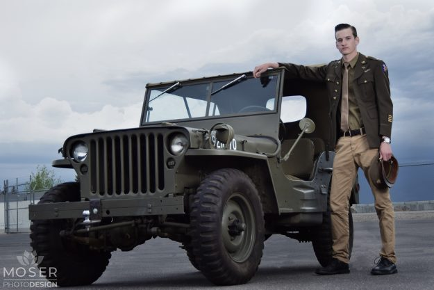 Army man standing outside the jeep