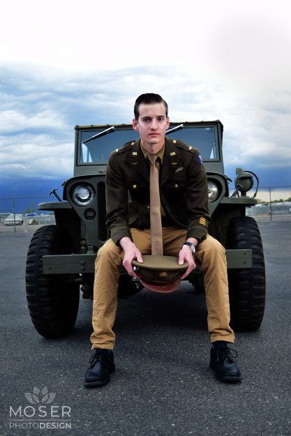 Soldier sitting on the bumper of the jeep