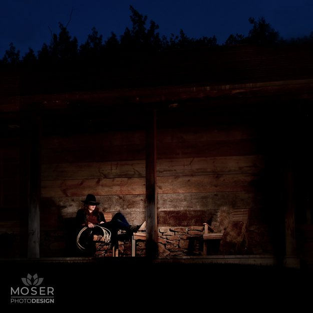 Cowgirl Relaxing in chair on the porch at night