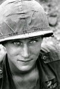 Alexis-Moser-A-Tribute-to-our-soldiers-An-American-soldier-wears-a-hand-lettered-War-Is-Hell-slogan-on-his-helmet-Vietnam-1965