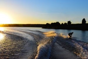 Alexis-Moser-on-the-water-sun-lit-wakes
